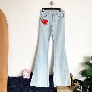 GUCCI embroidered heart & dagger jeans